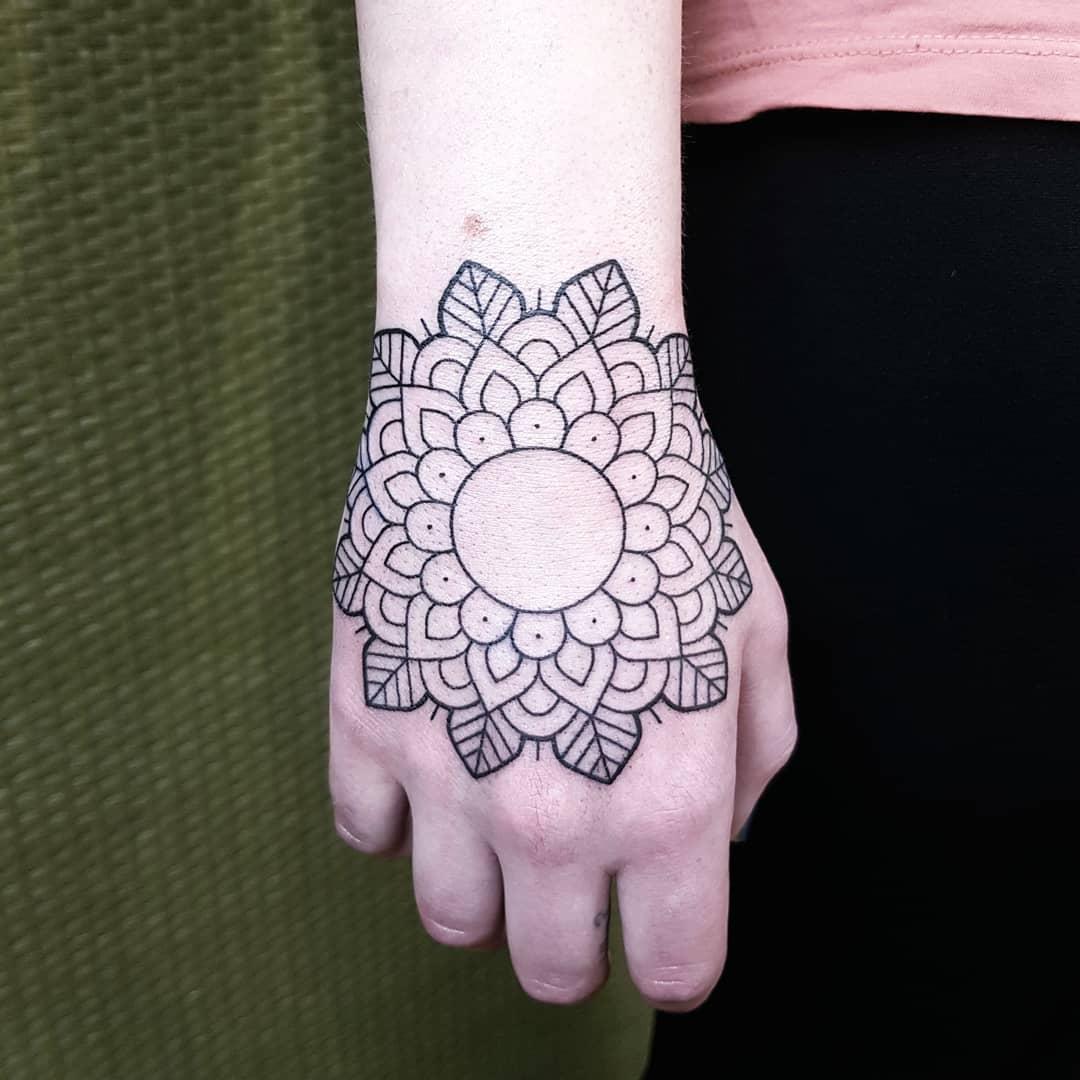 Linework mandala tattoo