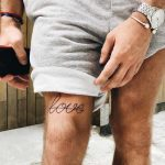 Love tattoo behind the knee