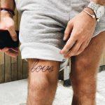 Love tattoo behind the knee