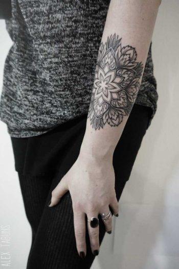 Mandala on the forearm by Alex Tabuns