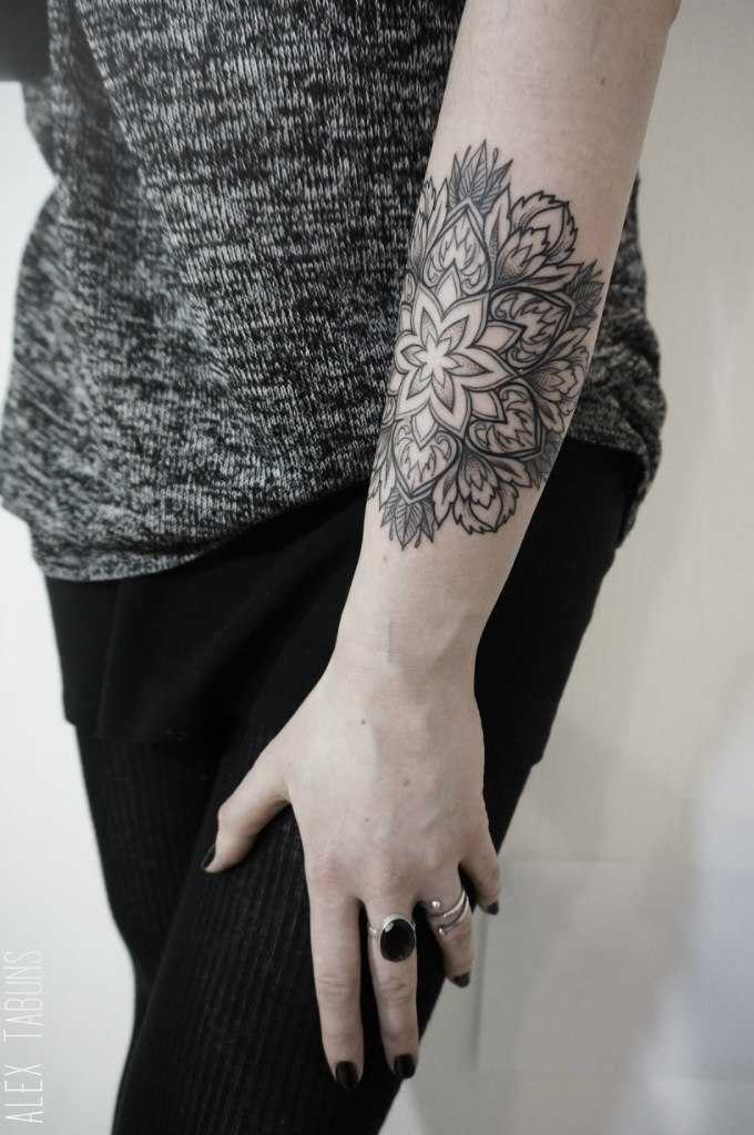 Mandala on the forearm by Alex Tabuns