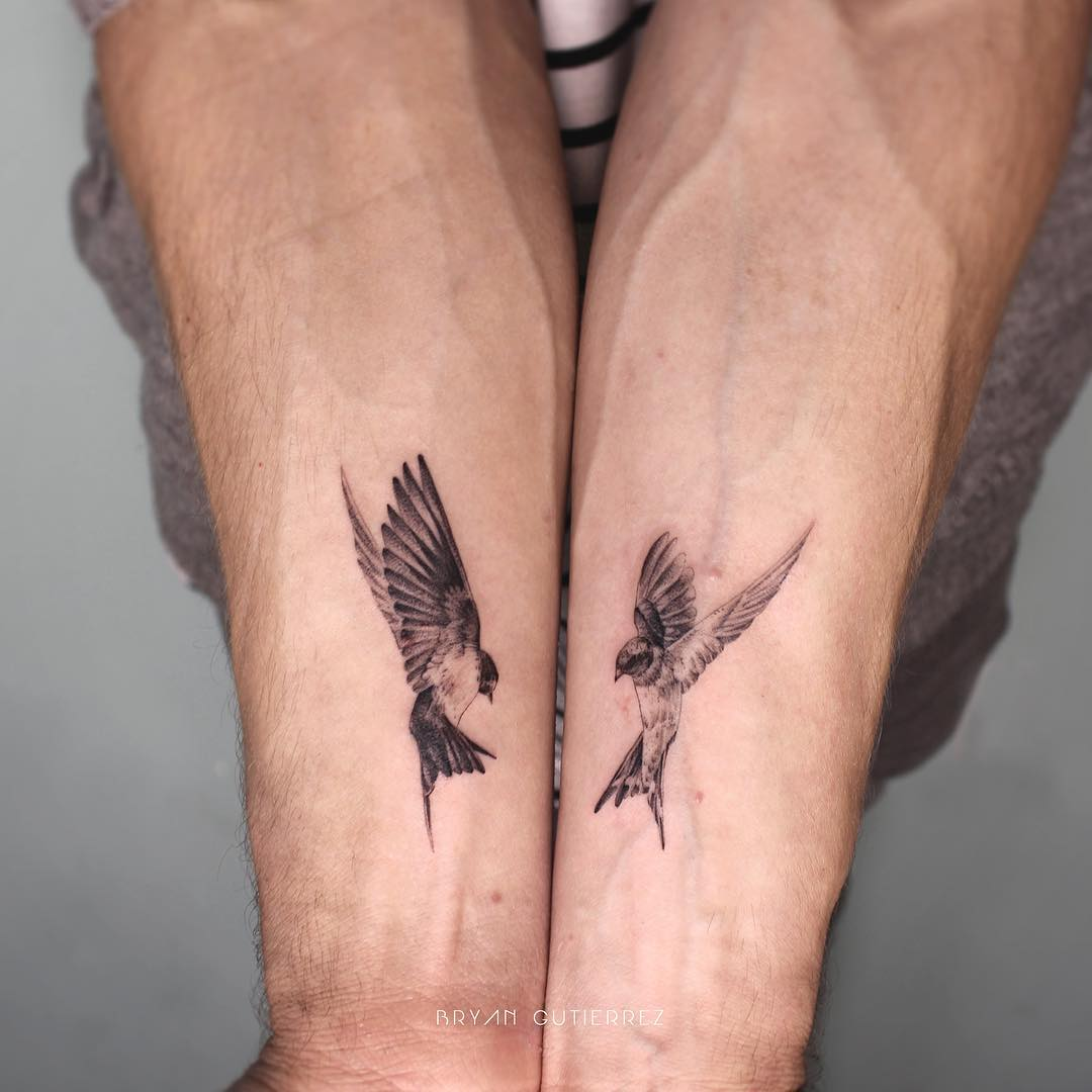 Matching bird tattoos by Bryan Gutierrez