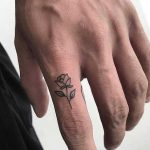 Micro rose tattoo on the finger