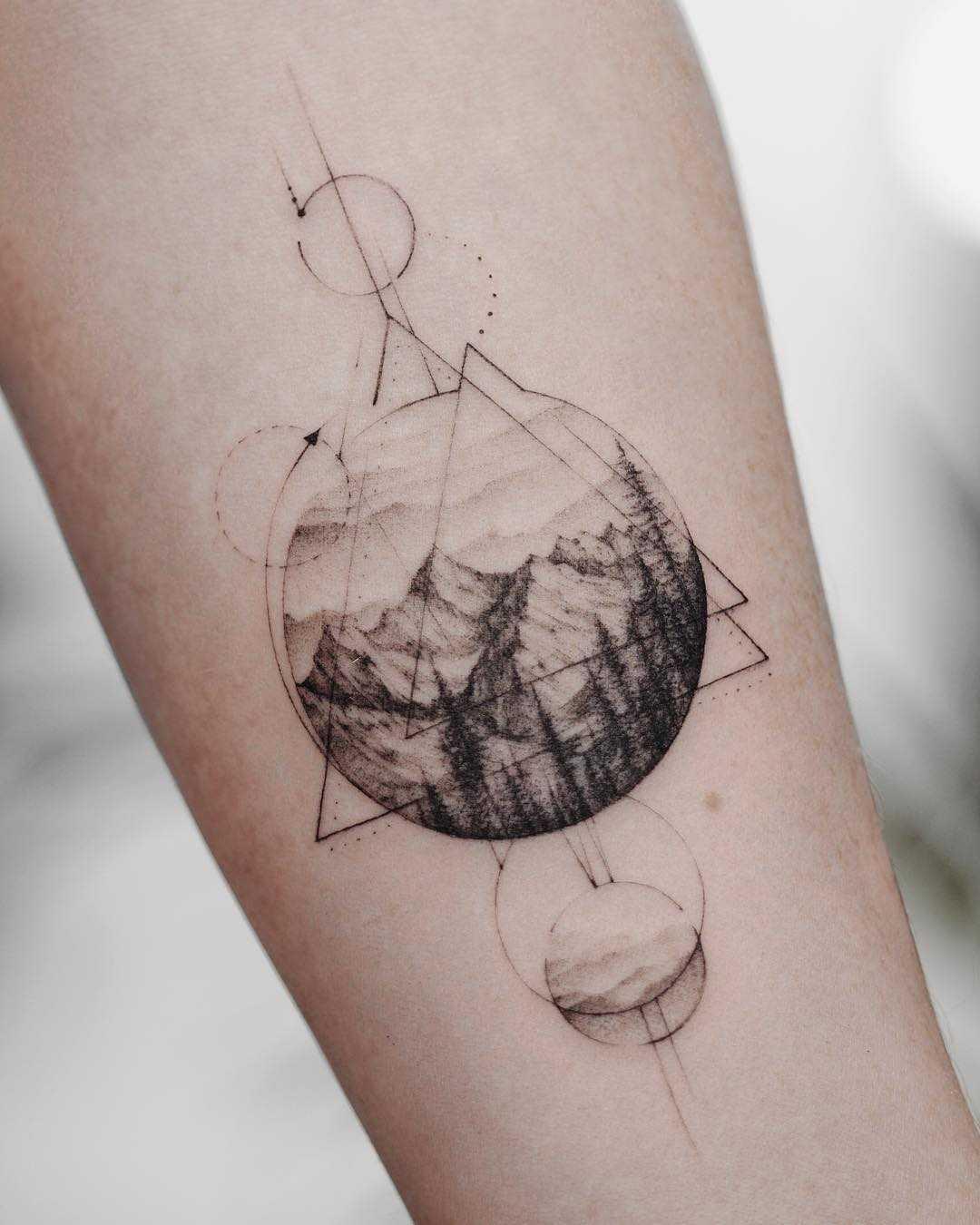 Mountainous landscape and geometry tattoo