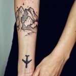 Mountains and plane tattoo
