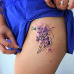 Orchids tattoo on the left hip