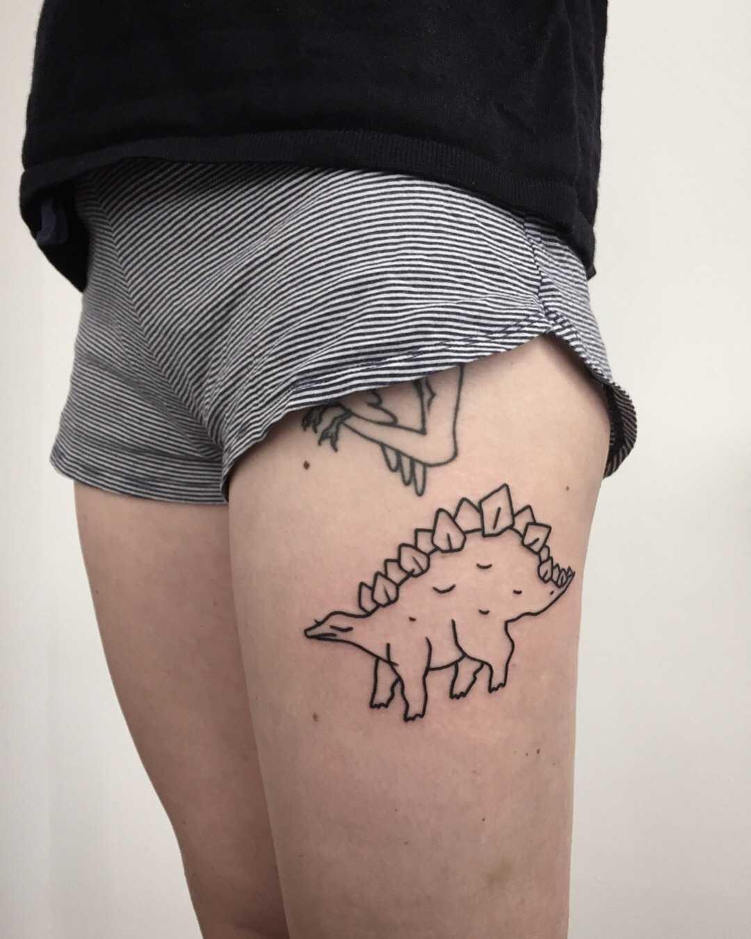 Outline dino tattoo