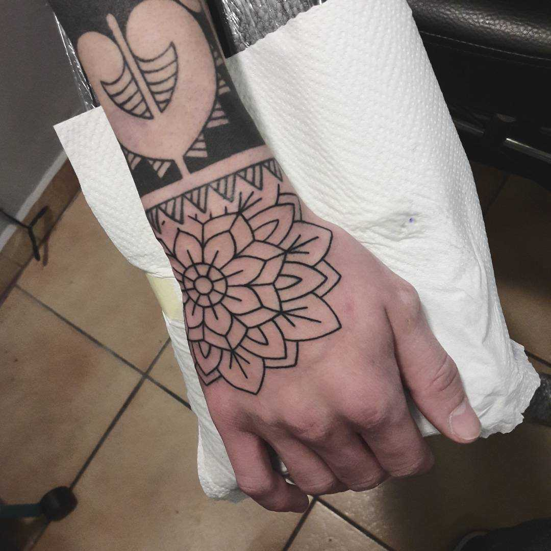 Outline flower tattoo on the right hand