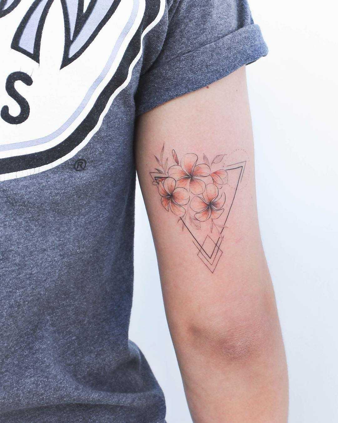 Plumerias with a hint of orange by Iris Tattoo