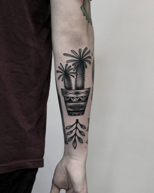 Potted pachypodium and a sprig of greenery tattoo