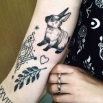 Rabbit, twig, and hear tattoos