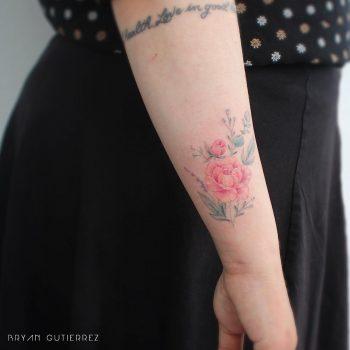 Red flower tattoo by Brian Gutierrez
