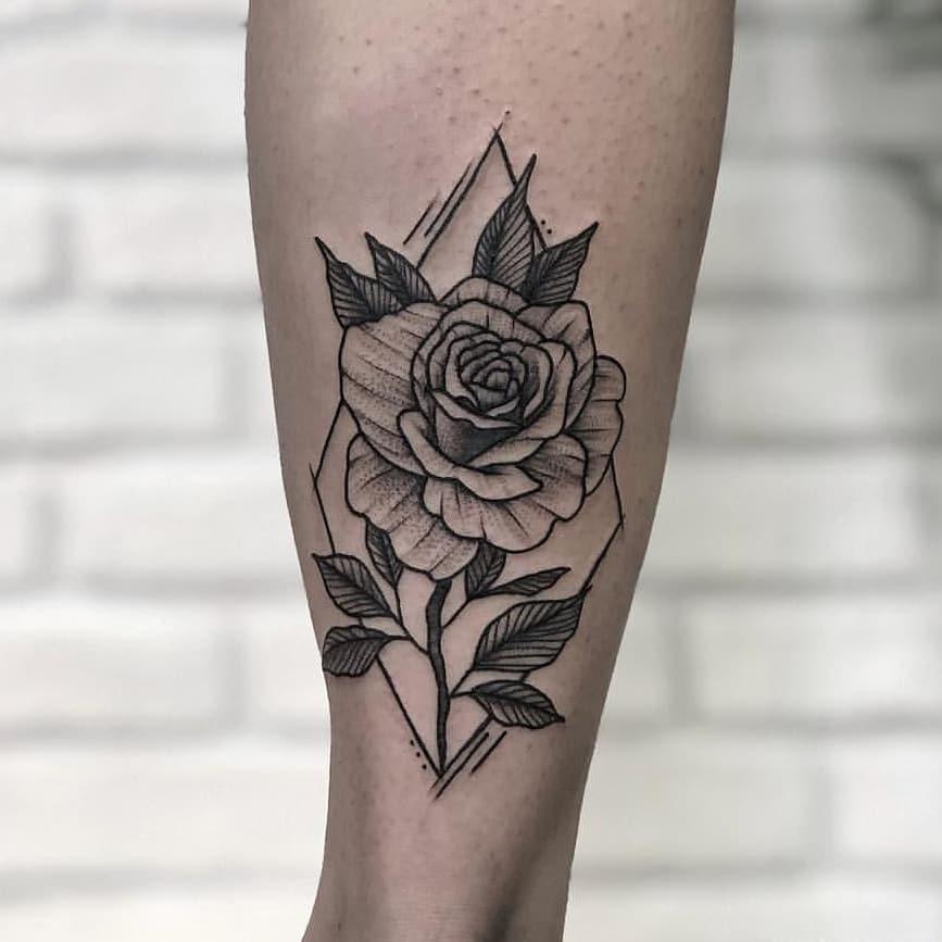 Rose in a rhombus tattooed on the calf