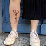 Scissors tattoo on the right shin