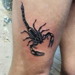 Scorpion tattoo on the right thigh