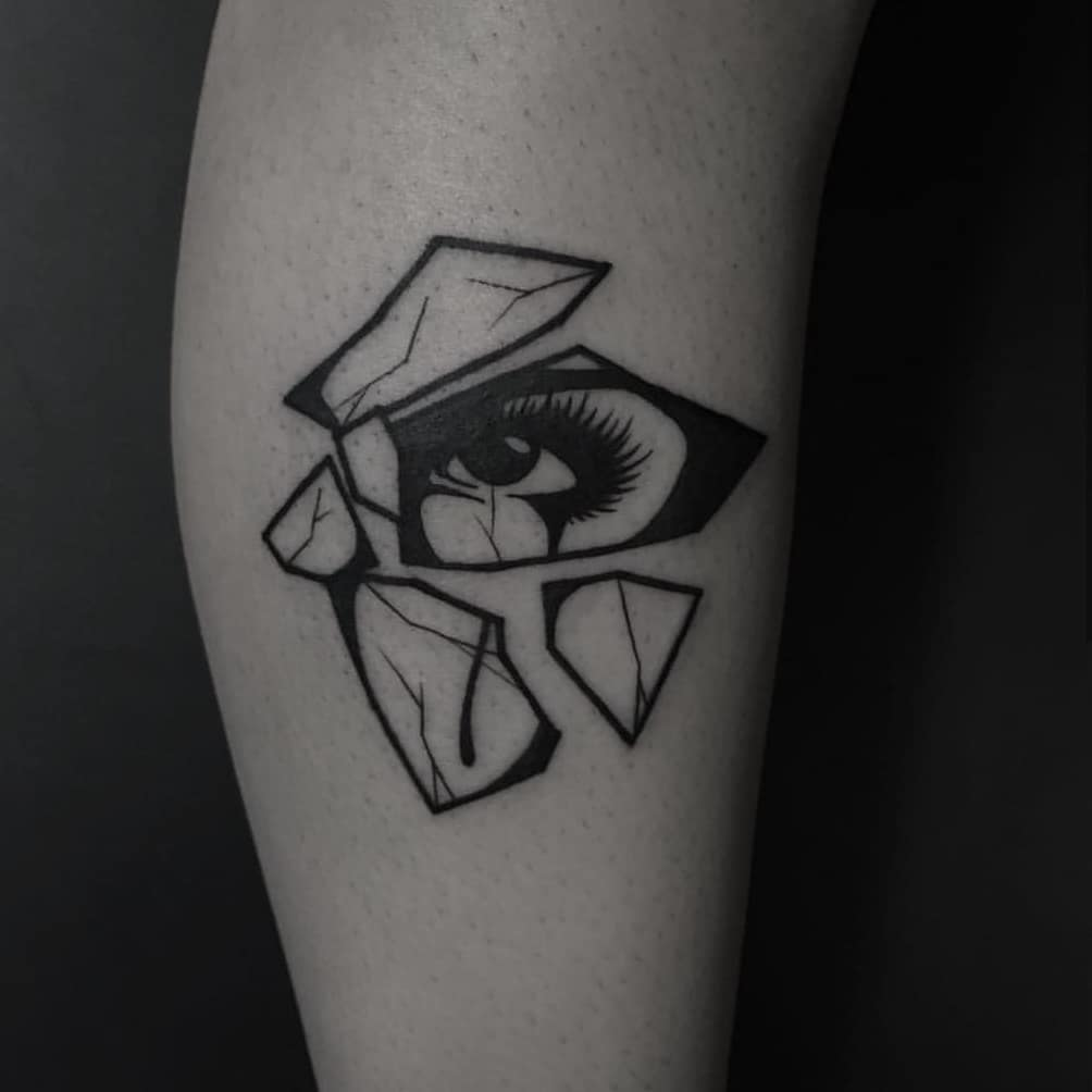 Shattered glass with an eye reflection tattoo
