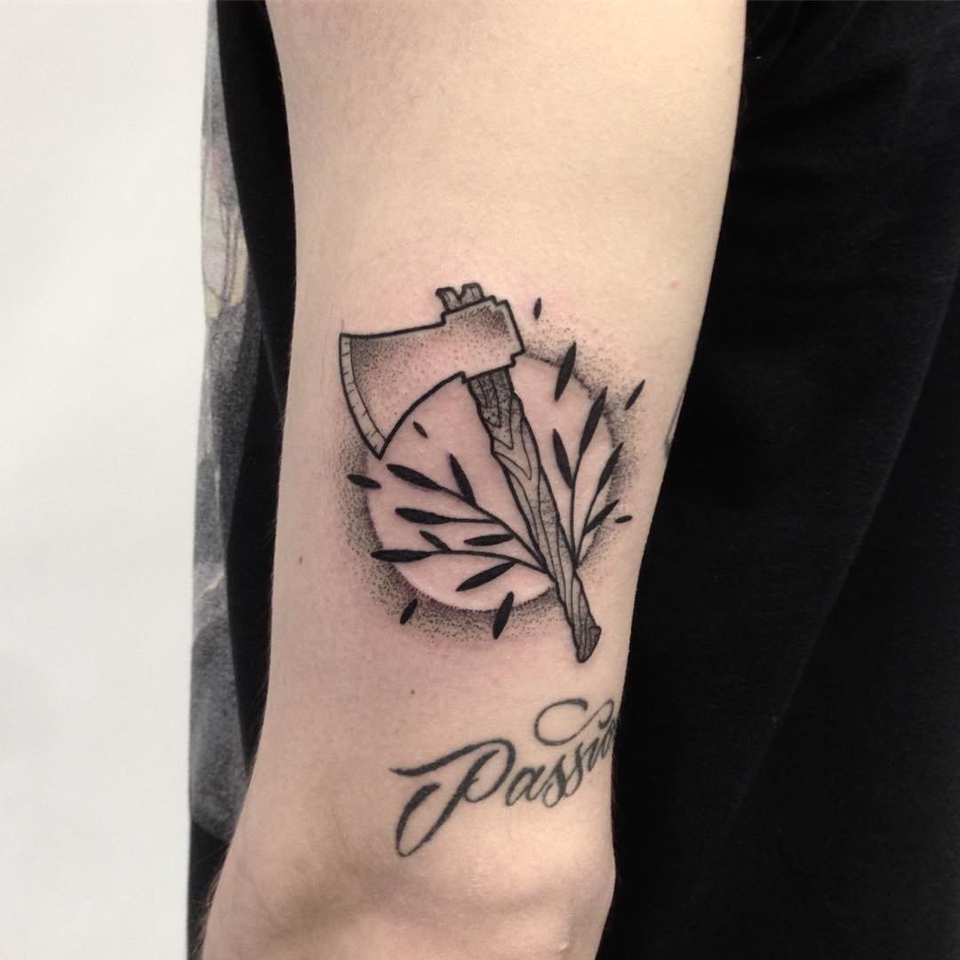 Simple axe and branches tattoo