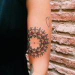 Simple mandala tattoo on the arm