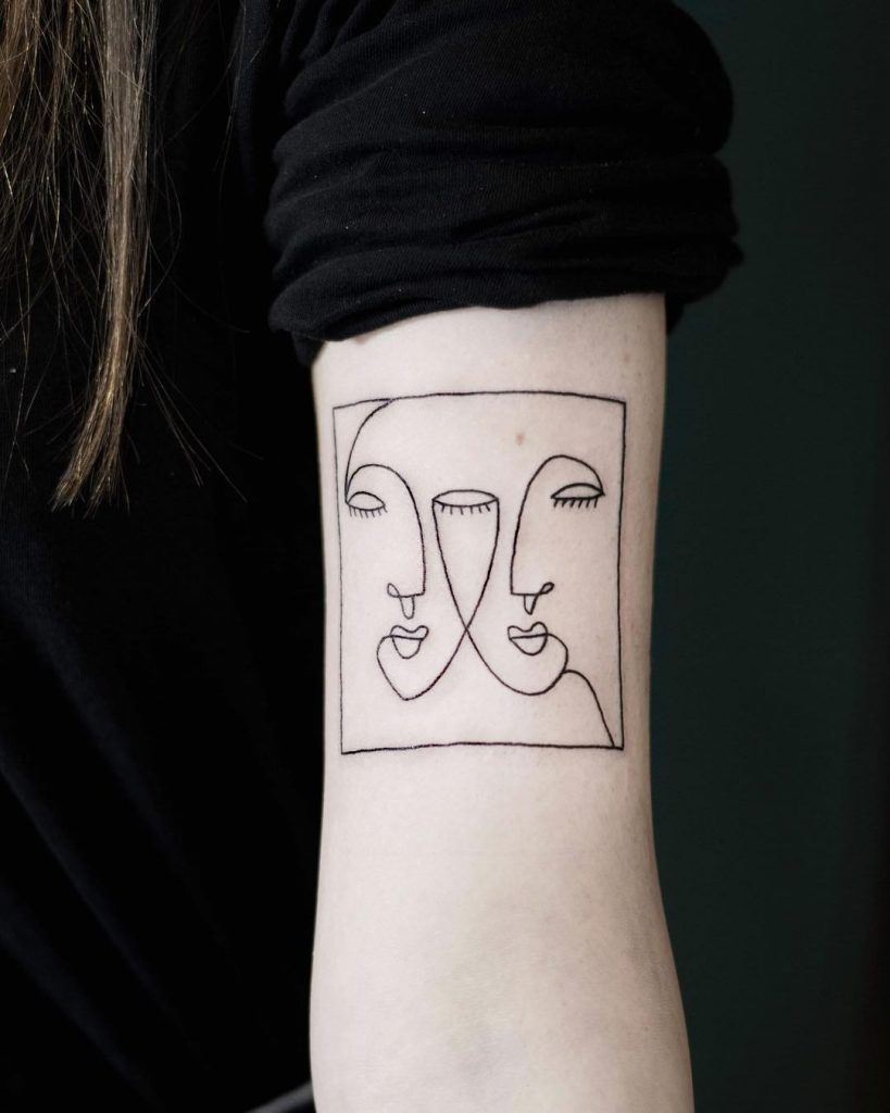Sketchy double face tattoo