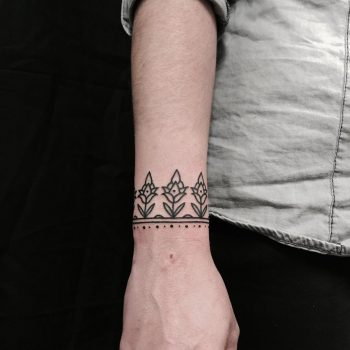 Small floral bracelet tattoo on the wrist
