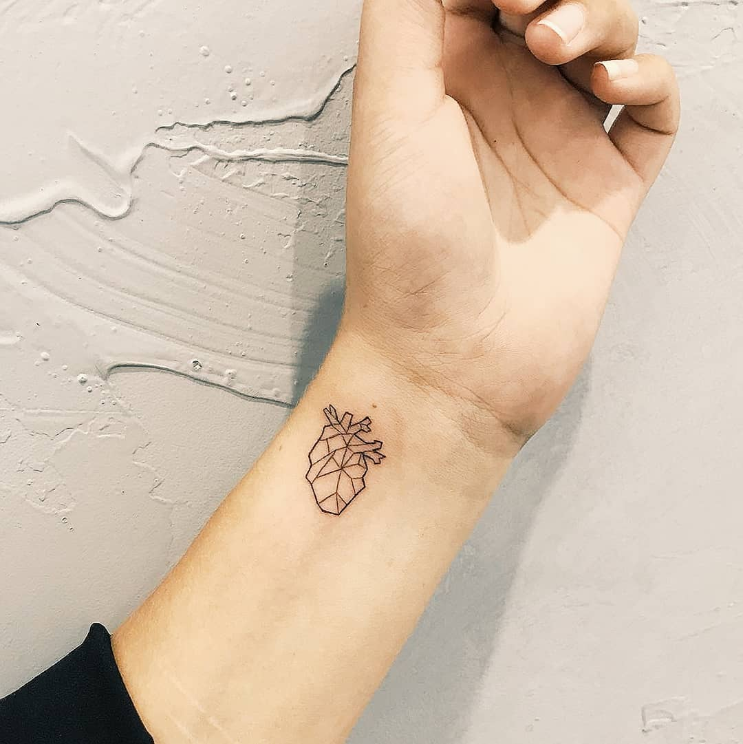 Small heart tattoo by Cholo