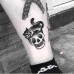 Small kitty and skull tattoo by Twelve Seconds