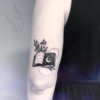 Spellbook tattoo on the triceps