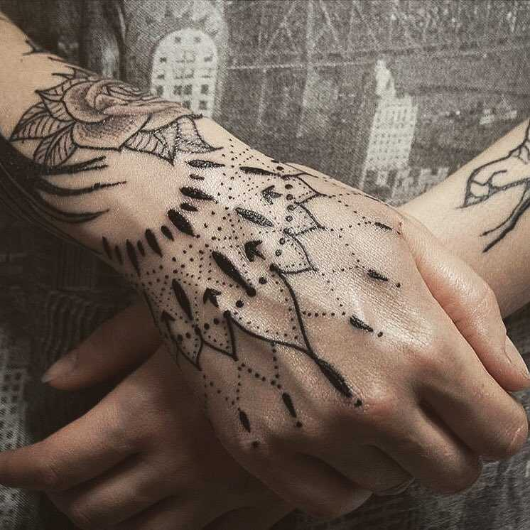Superb hand tattoo by Unkle Gregory