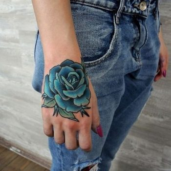 Teal rose tattoo on the hand