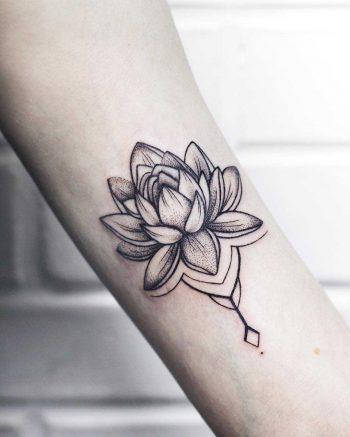 Tiny tender lotus tattoo