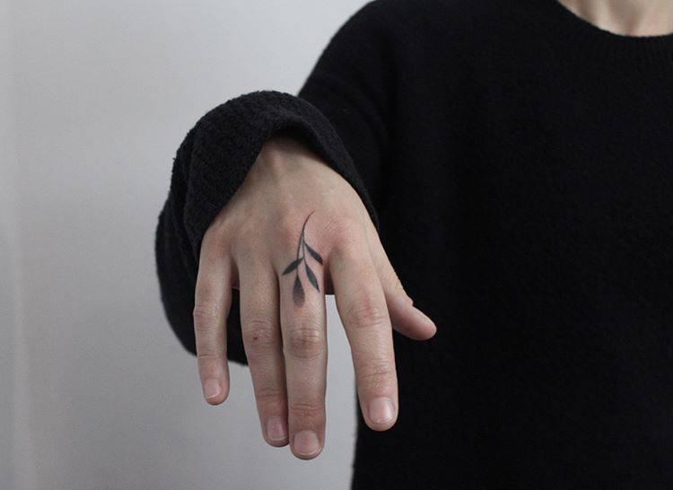Tiny twig tattoo by Lara M J