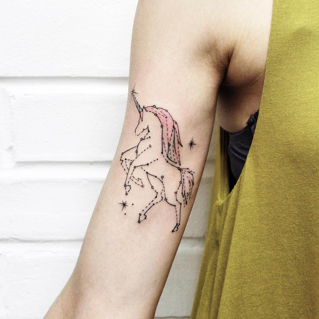 Unicorn tattoo on the right arm