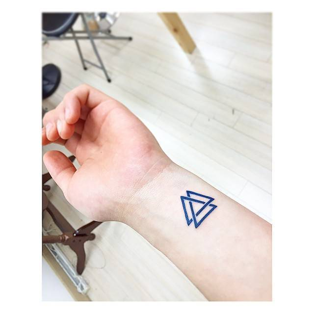 Valknut tattoo on the left wrist