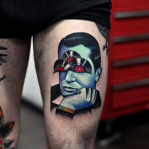 Vinyl man tattoo done at Fronte Del Porto Tattoo studio