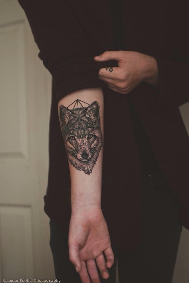 Wolf head and geometric shape tattoo
