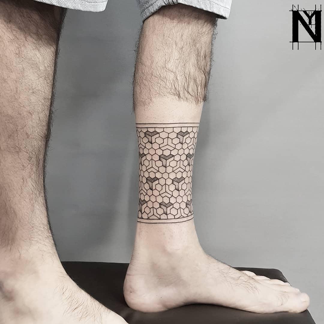 3D geometric pattern tattoo on the leg