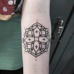 Basic floral cross tattoo