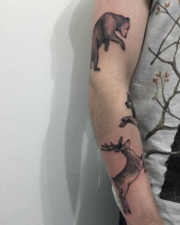 Bear, wolf, and deer tattoos