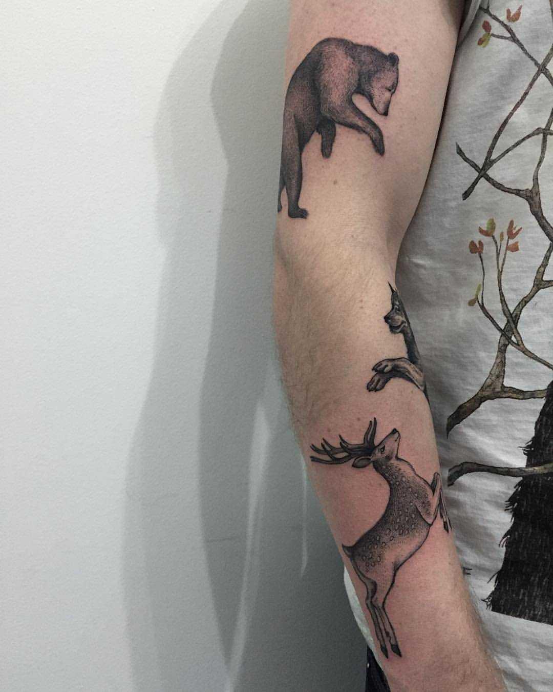 Bear, wolf, and deer tattoos