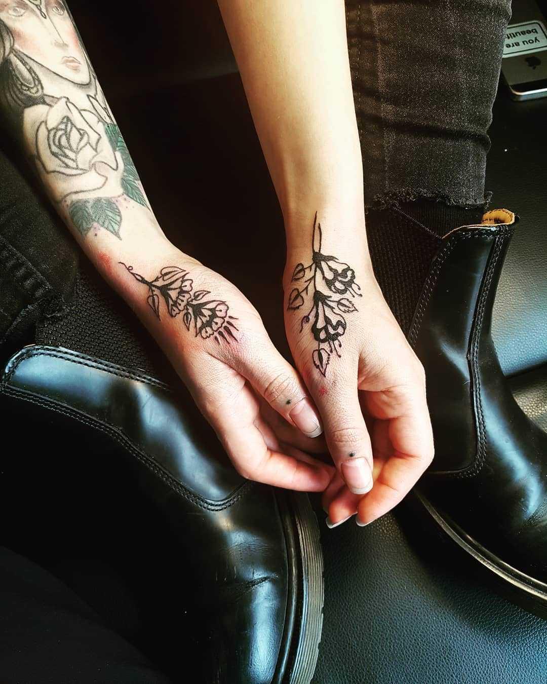 Beautiful black flowers on both hands