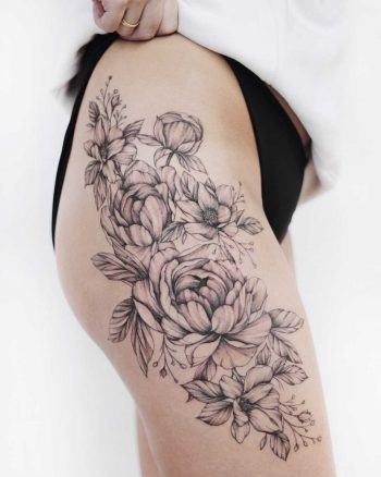 Black and grey floral piece on the thigh