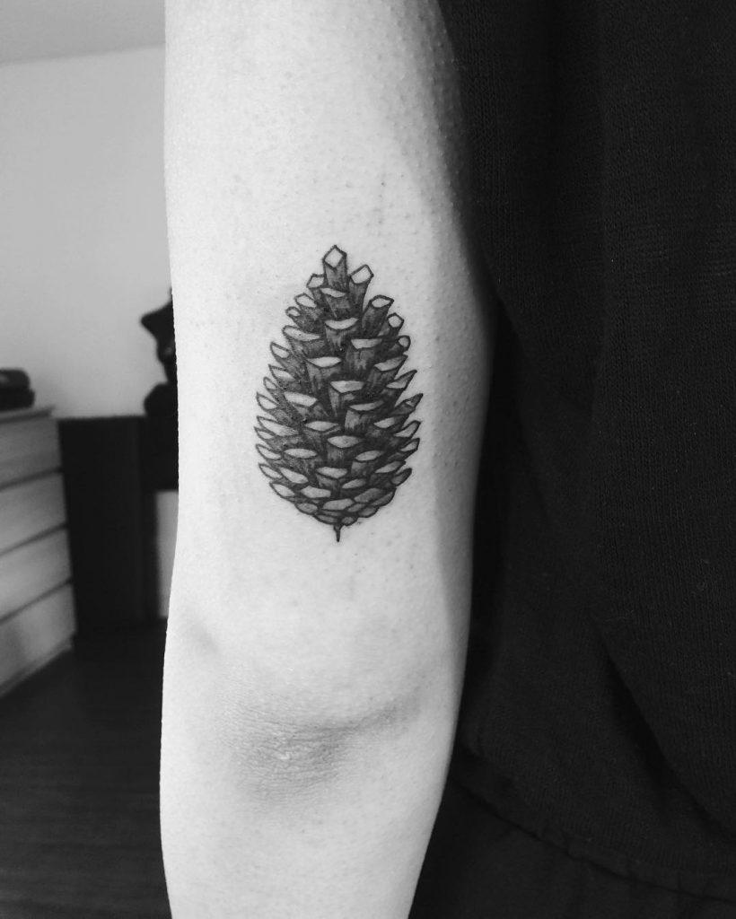 Black and grey pine cone tattoo