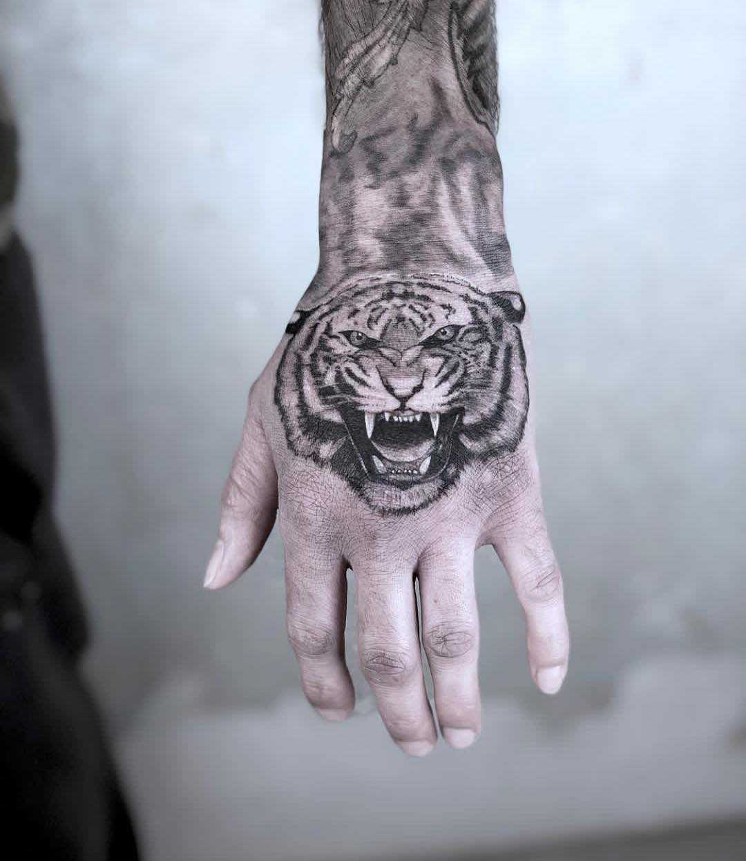 Black and grey tiger tattoo on the hand