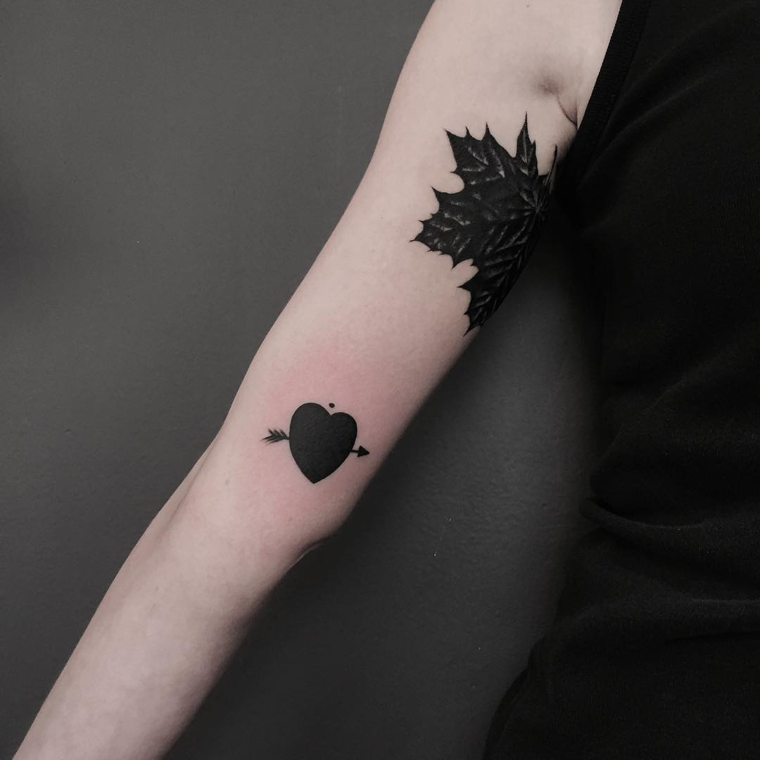 Black heart and arrow tattoo