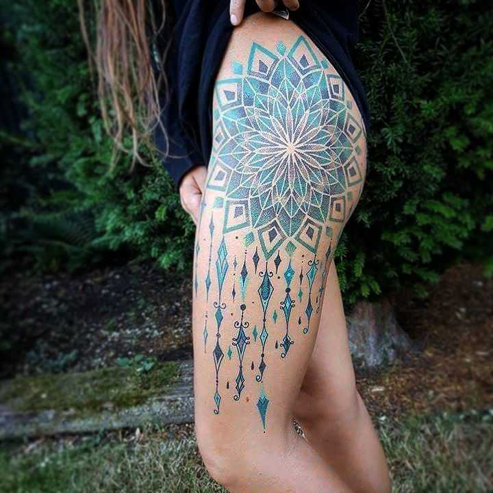Blue and teal mandala tattoo on the hip