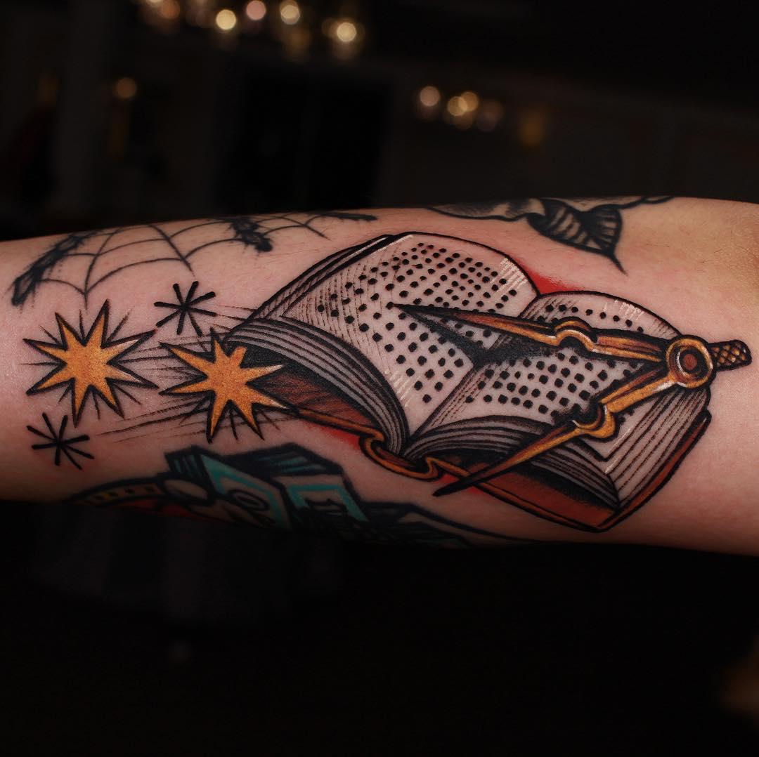 Book and callipers tattoo