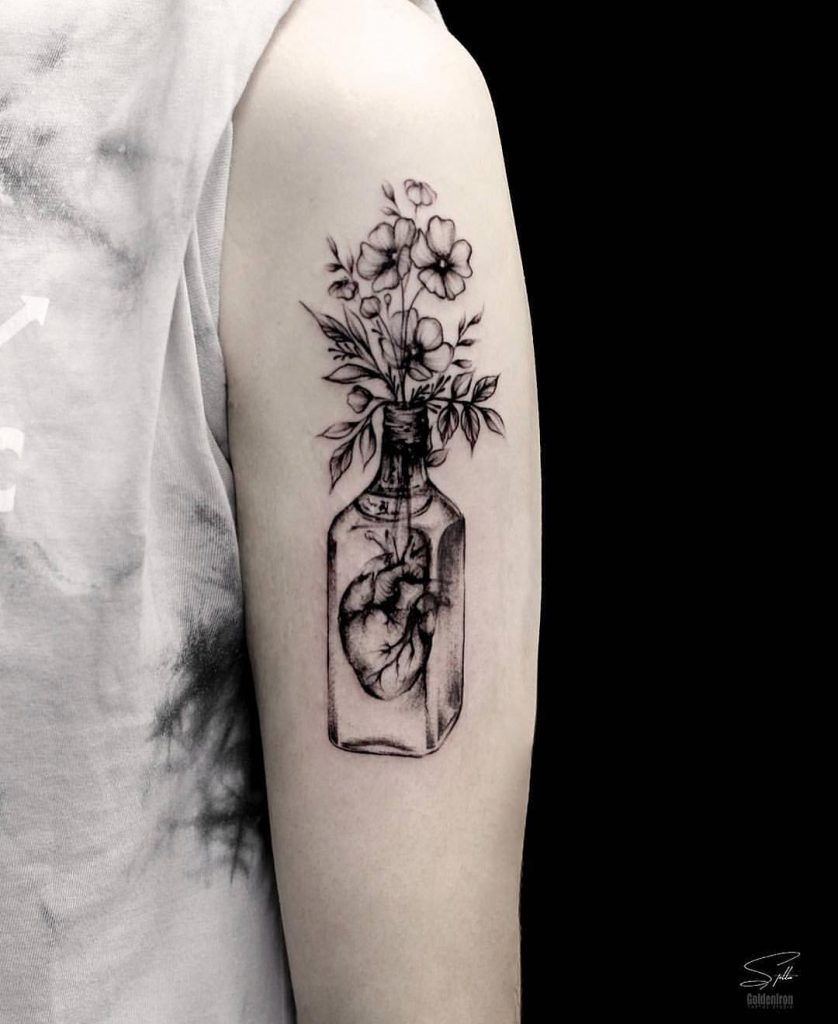Bottled heart and flower bouquet by Stella TX