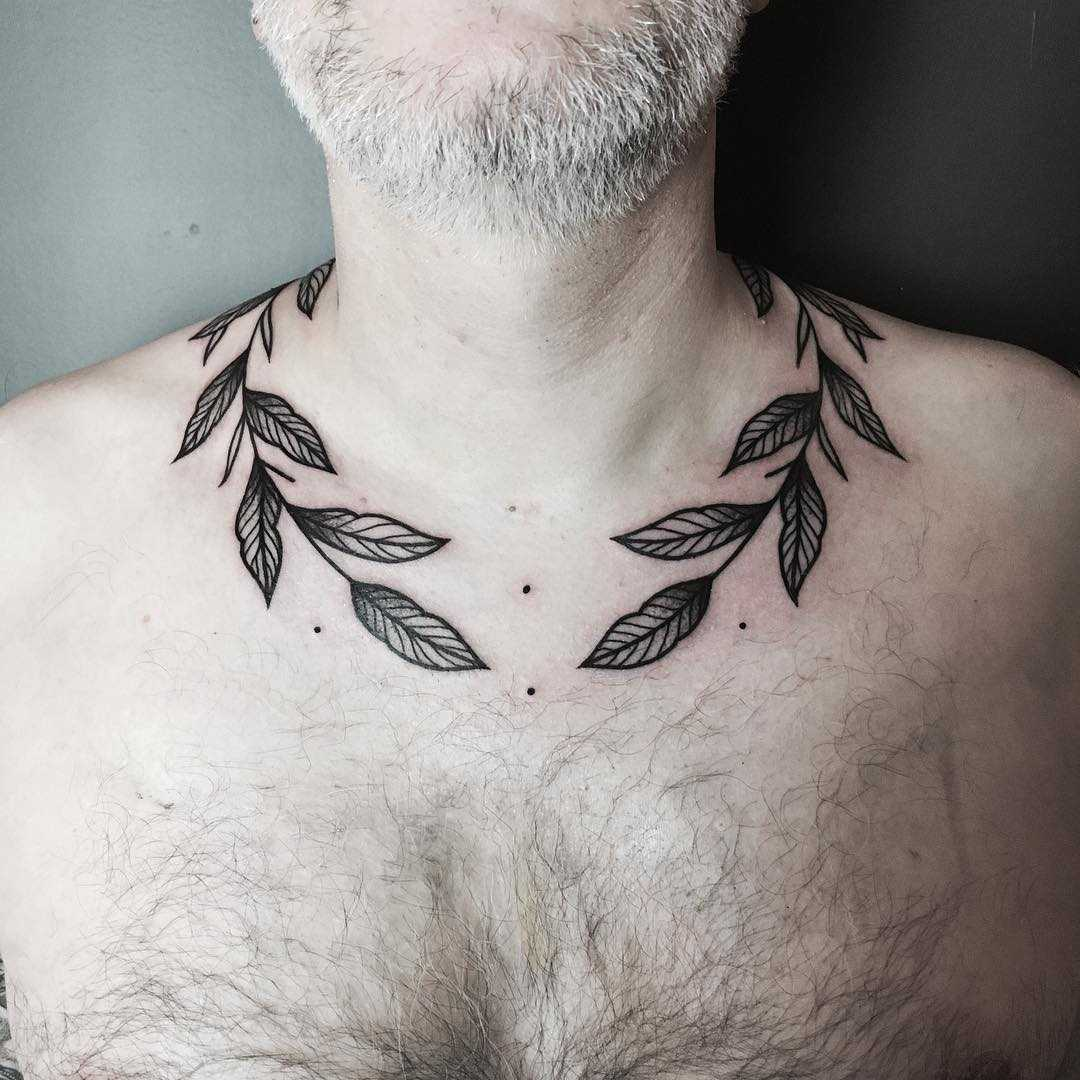 Branch tattoo wrapped around the neck