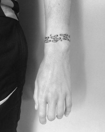 Broken chain bracelet tattoo