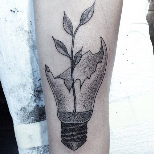 Broken light bulb and branch tattoo
